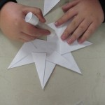 Student gluing sections of star together