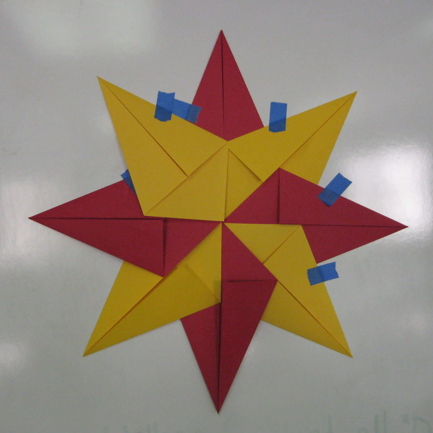 Christmas in July! Folded Paper Stars with Symmetry TeachKidsArt