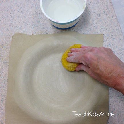 Lay slab over plate and smooth with sponge