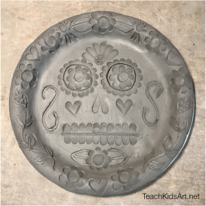Ceramic Sugar Skull Plate for Dia de los Muertos, before firing while clay is still wet.