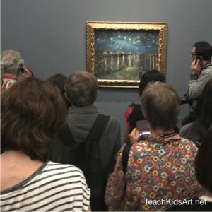 "Viewers contemplating Van Gogh's ""La Nuit Etoilé"", painted in 1888"